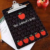 Teacher's personalized clip board features apples for teacher and their name.